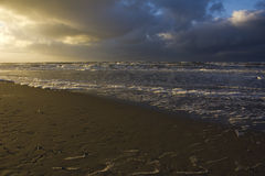 Two color sky at sunset beach Texel Stock Photography