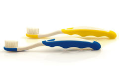 Two color toothbrushes Stock Photos