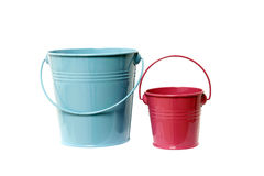 Two colored buckets. Isolated blue and red buckets with handle Royalty Free Stock Photo