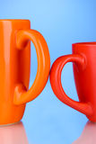 Two colored cups handles Royalty Free Stock Photos