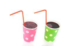 Two colored drinking cups with lemonade Stock Photos