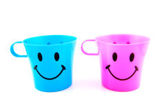 Two colored empty cups Royalty Free Stock Photos