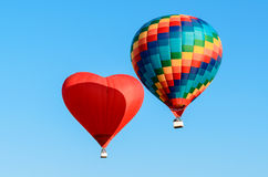 Two colored hot air balloon Stock Images