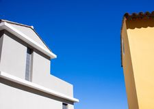 Two colored houses blue and yellow royalty free stock photo