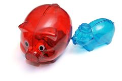 Two colored piggy banks royalty free stock image