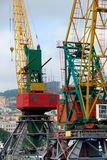 Two colored port cranes Royalty Free Stock Images