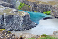 Two-colored river Gulfoss. Meeting of two rivers, a clear and a muddy Royalty Free Stock Image