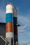 Two colored silo. On blue sky background Royalty Free Stock Image