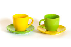 Two colored tea cups and saucers. Stock Photo
