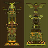 Two colored totem poles Stock Photo