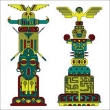 Two colored totem poles Stock Photography