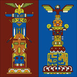 Two colored totem poles Royalty Free Stock Photography