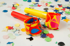 Two colored whistles. Colored whistles to make noise on carnival parties Royalty Free Stock Photos