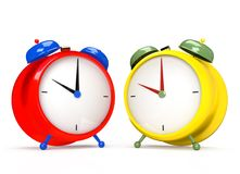 Two colorful alarm clocks on white background. Stock Images