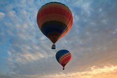 Two hot air balloon in the sky at sunset. Royalty Free Stock Images