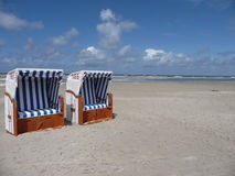 Two colorful beachchairs on the island of amrum Stock Photos