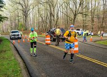 Two Colorful and Bearded Runners Competing  - 2019 Blue Ridge Marathon. Roanoke County, VA – April 13th: Two very colorful and bearded runners, competing stock images