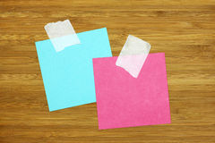 Two colorful blank note card on wooden texture Royalty Free Stock Image