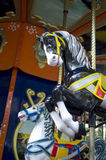 Two colorful carousel horses on funfair Stock Images