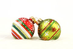 Two colorful Christmas balls on white fur background. Horizontal Royalty Free Stock Images