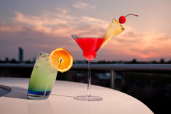 Two colorful cocktails. Closeup of two colorful cocktails in the sunset stock images
