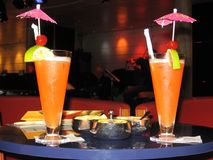 Two colorful coctails on the table of a cruise ship bar on vacation Stock Images