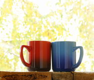 Two colorful coffee mugs Royalty Free Stock Photos
