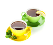 Two colorful cups of tea with lemon and mint Royalty Free Stock Photography