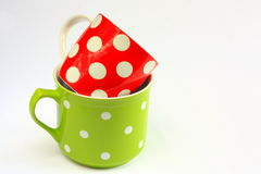 Two colorful cups with white polka dots Royalty Free Stock Photo