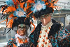 Two colorful and extravagant masks at the carnival stock photography