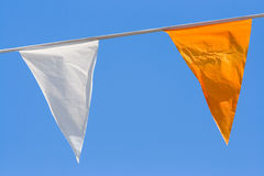 Two colorful flags on blue sky Stock Photo