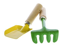 Two Colorful Garden Tools. Two Colorful Garden Hand Tools:yellow hand trowel, and a green pitch fork, isolated on white Stock Image