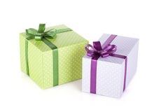 Two colorful gift boxes with ribbon and bow Royalty Free Stock Images