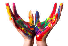 Two colorful hands form a cup. Two painted colorful hands form a cup in front of white background Stock Image