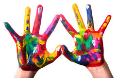Two colorful hands forming a heart V2. Two painted colorful hands forming a heart on a white background Royalty Free Stock Photo