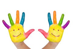 Two colorful hands with smile Stock Photo