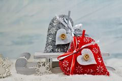 Two colorful hearts on a sleigh - The magic of Christmas Stock Image