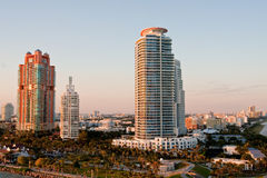 Two Colorful High Rise Tropical Condos. Luxury high rise condo buildings in a tropical location in morning light Stock Images