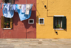 Two colorful houses of Burano Island with laundry, Venice, Italy Stock Photo