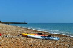 Two colorful kayaks at Seven sisters Beach. Stock Images