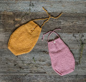 Two colorful knitted overalls for newborn baby Royalty Free Stock Photos