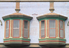 Two Colorful Old Windows Pattern Downtown Stock Photography