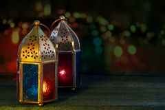 Two colorful oriental Lamp lanterns burn with candles with color Royalty Free Stock Image
