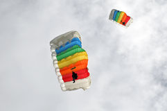 Two colorful parachutists Stock Photography