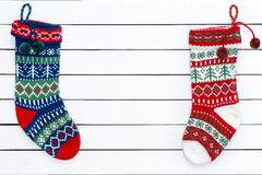 Two colorful patterned Christmas stockings Stock Photo