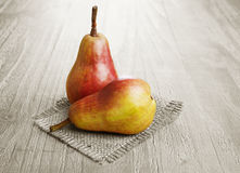 Two colorful pears Royalty Free Stock Photos