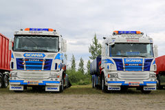 Two Colorful Scania Tipper Trucks in a Show Stock Images
