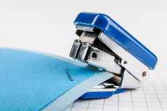 Stapler. Two colorful sheets of paper stapled by the stapler Stock Photography