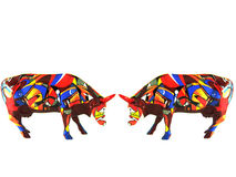 Two colorful small porcelain cows. Two porcelain cows featuring European flags facing each other on white background Stock Photography
