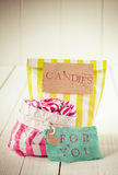 Two colorful striped bags of candies with tags Royalty Free Stock Images